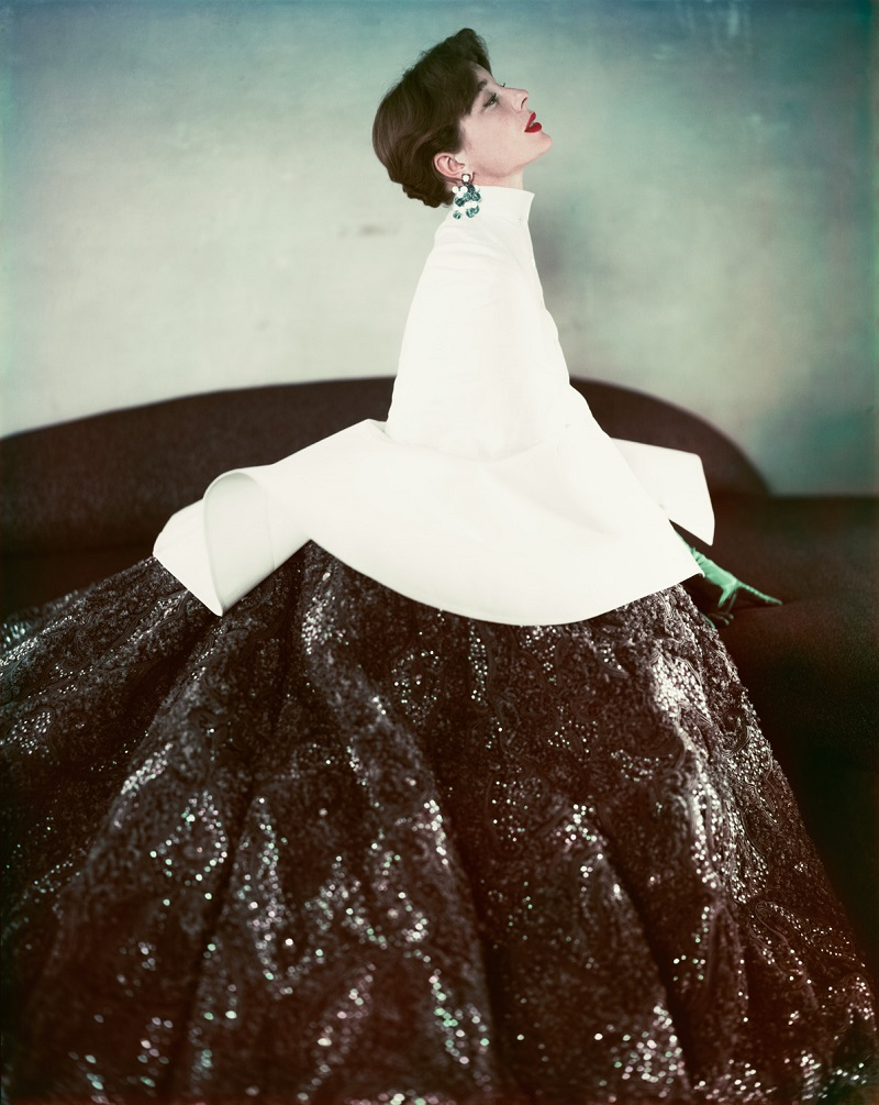 Milton H. Greene took this vintage fashion color photograph of model Bettina wearing a classic, 1952 Givenchy dress while on assignment for Life Magazine. Bettina is wearing red lipstick and short, brown hair.